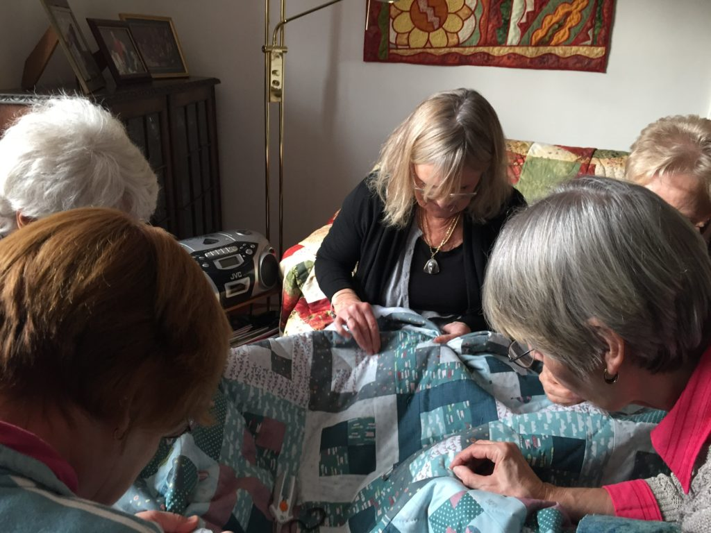 Riverside Quilters group working on a quilt for the Grenfell Tower Appeal