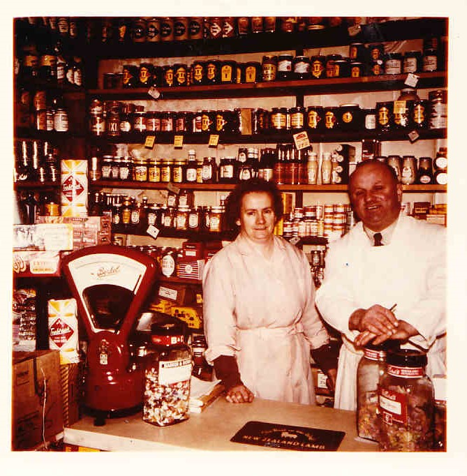 Mr and Mrs Ryder behind the counter of their grocery shop
