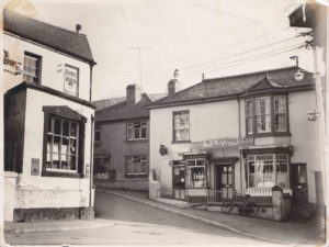 Black and white photo of the shop at the corner of Fore St. and Radway Hill