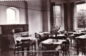 Black and white photograph of the dining room at Murley Grange, Bishopsteignton, when it was a hotel