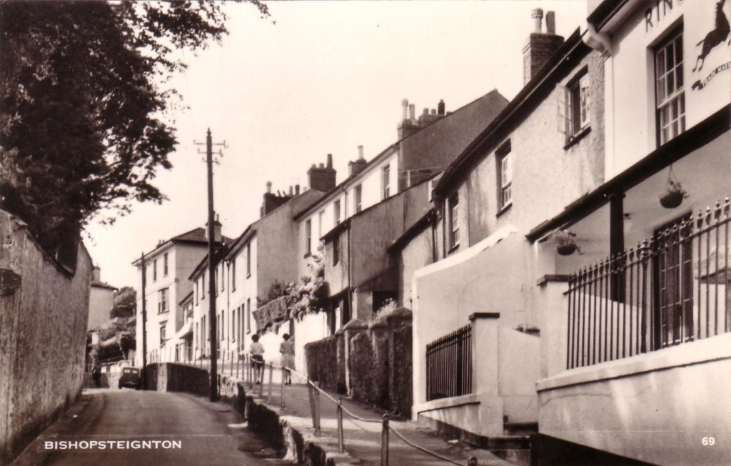 Black and White postcard of Fore Street, Bishopsteignton showing position of blacksmith.