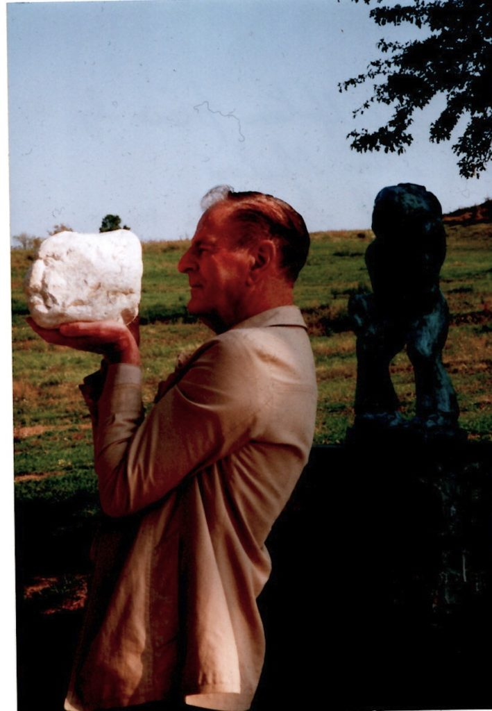 "Philip Gourd with ""Sculpture piece by Dino Milani with his Pieta in background, Monte Sole, Sept 1998""."