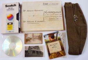 Photograph of a selection of archive material from the Bishopsteignton Heritage collection.