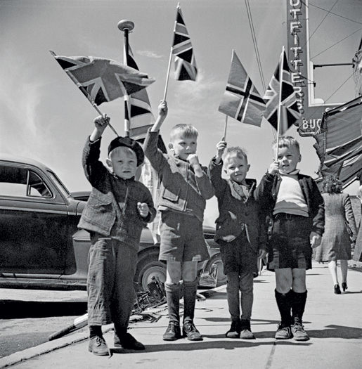 Children waving flags VE Day