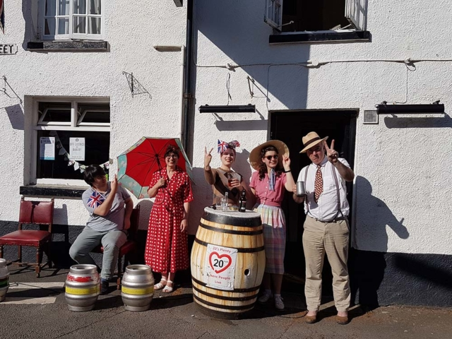 Photograph of Smith family outside Old Commercial Inn, Bishopsteignton