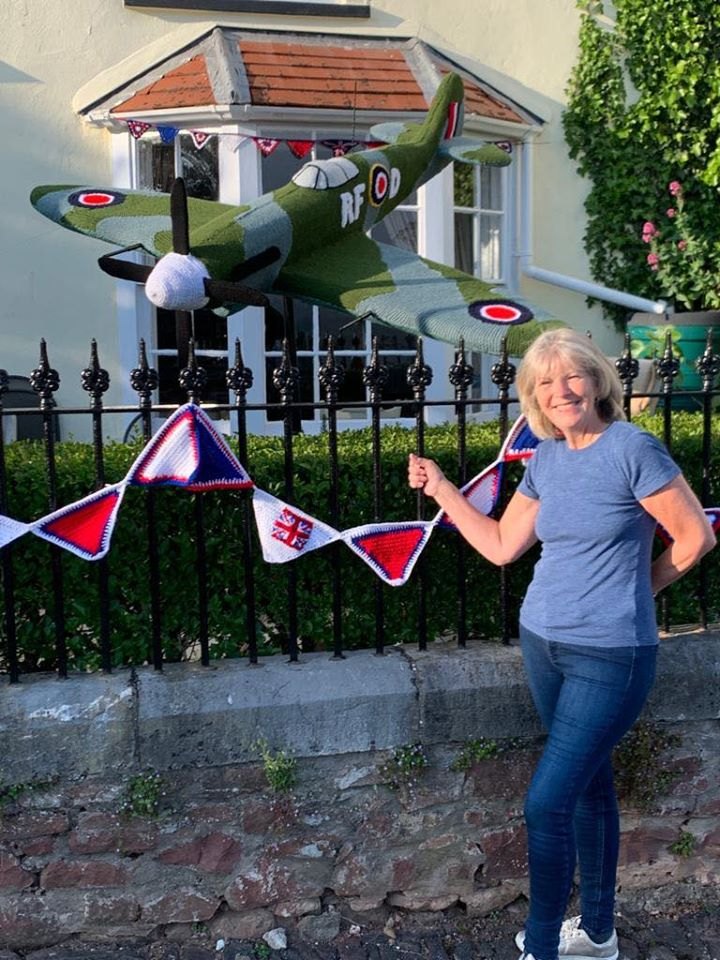Poster girl Caroline with her amazing knitted spitfire tribute