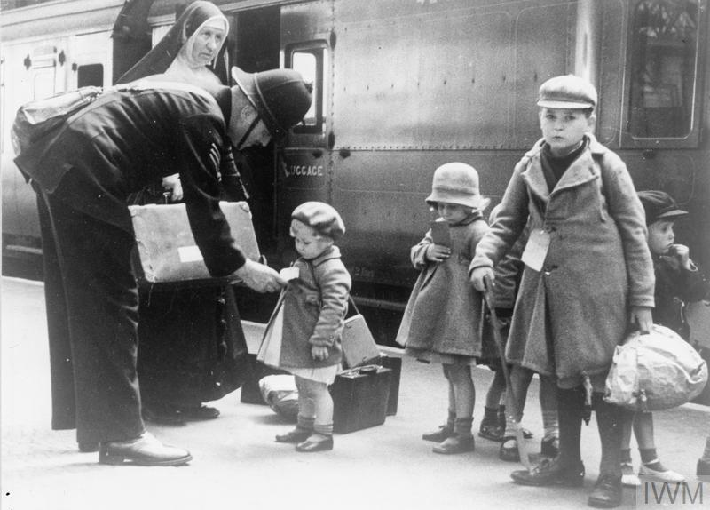 THE CIVILIAN EVACUATION SCHEME IN BRITAIN DURING THE SECOND WORLD WAR (LN 6194) A policeman helps some young evacuees, and a nun who is escorting them, at a London station. Copyright: © IWM. Original Source: http://www.iwm.org.uk/collections/item/object/205019036