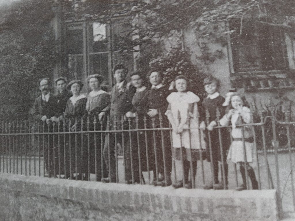Clifford Wallis and his family outside of Bishopsteignton School c 1914