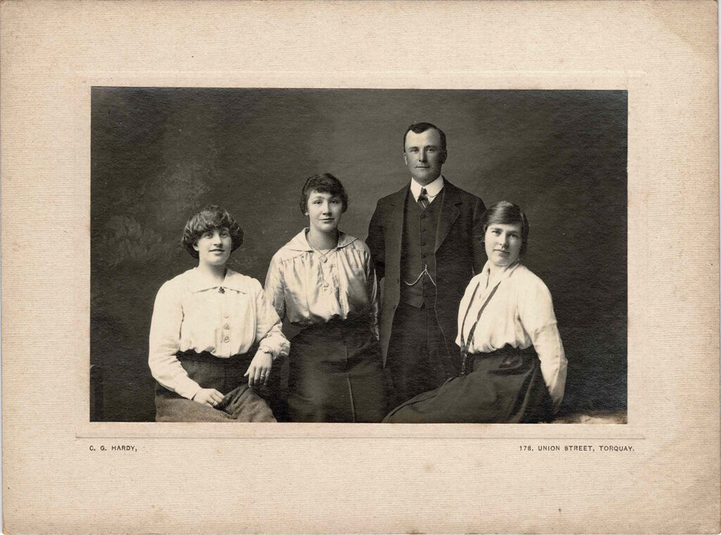 Photograph of Grace Coombe née Loud (centre left) with 2 unidentified women and an unidentified man.