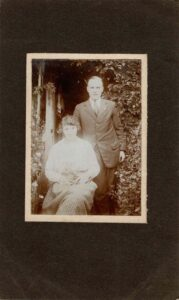Photograph of Grace Coombe née Loud with a cat and Philip Coombe, around 1925.