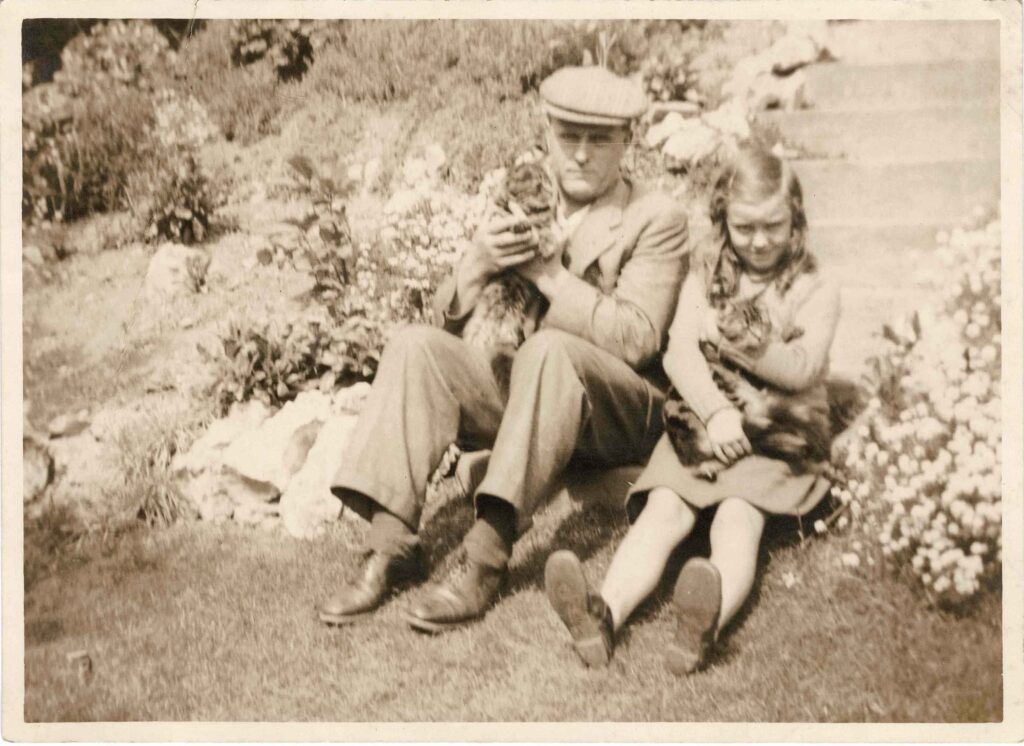 Photograph of Philip and Molly Coombe with cats, c. 1935.