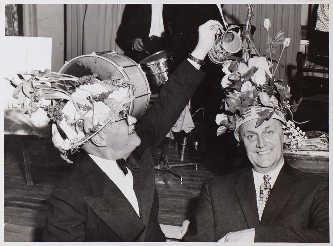 Photograph of two Bishopsteignton Players wearing Easter Bonnets