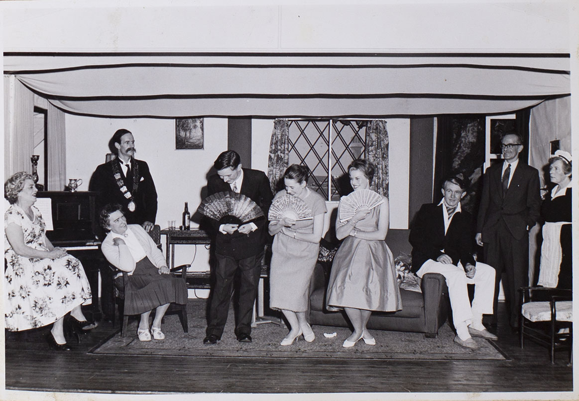 Photograph of cast members playing a scene in the play 'The Blue Goose' presented by Bishopsteignton Players in 1961