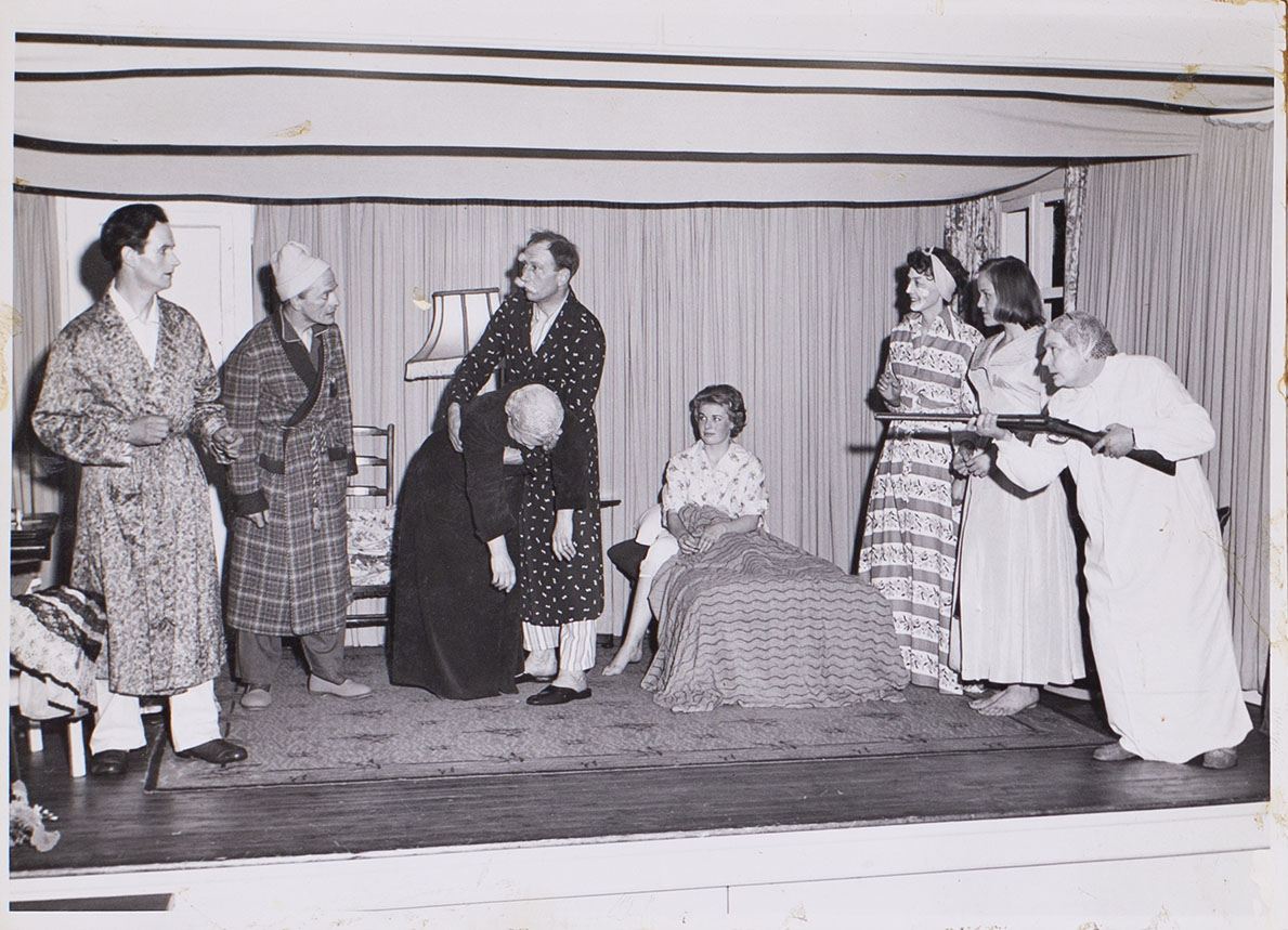 Photograph of cast members in a scene from the play 'Jane Steps Out' presented by Bishopsteignton Players