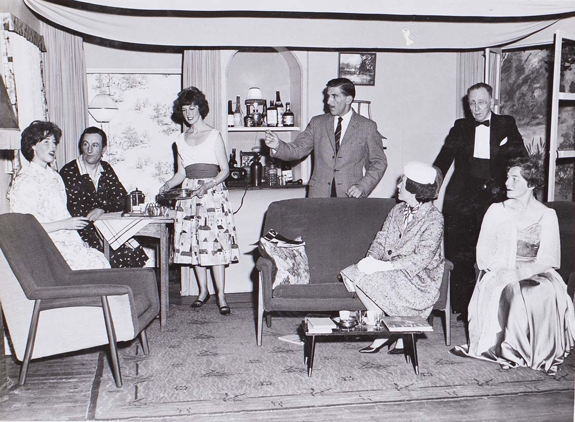 Photograph of the cast in a scene from the play 'Wolf's Clothing' presented by Bishopsteignton Players in 1964