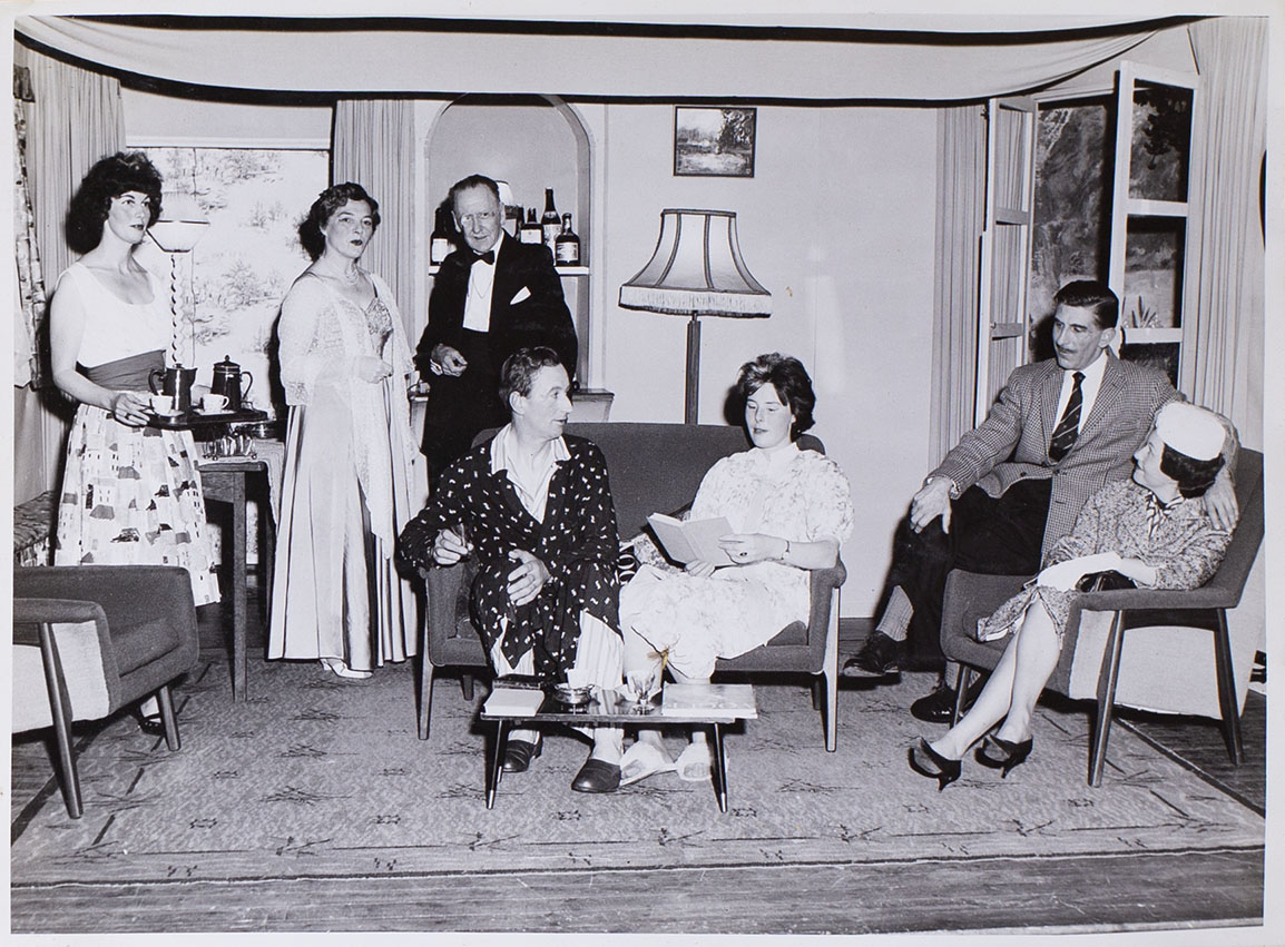Photograph of the cast in a scene from the play 'Wolf's Clothing' presented by Bishopsteignton Players in the Village Hall 1964