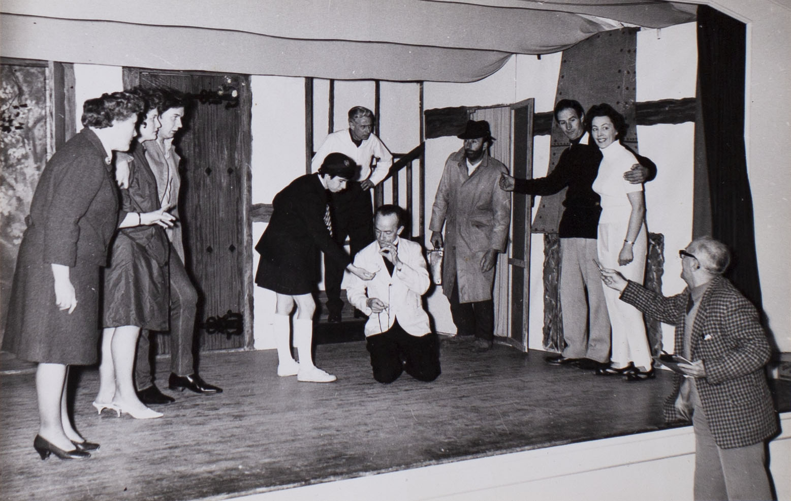 Photograph of the cast in a scene from the play 'Here We Come Gathering' presented by Bishopsteignton Players