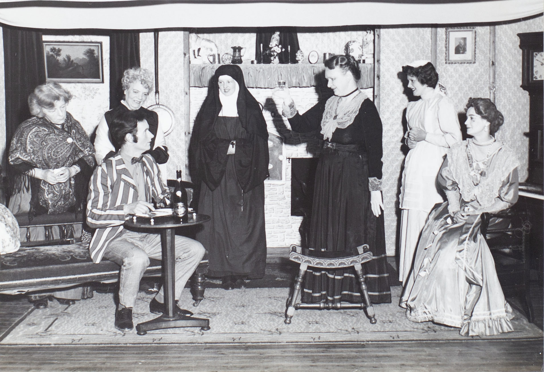 Photograph of some of the Bishopsteignton Players, in a scene from the 1960s play 'Ladies in Retirement'