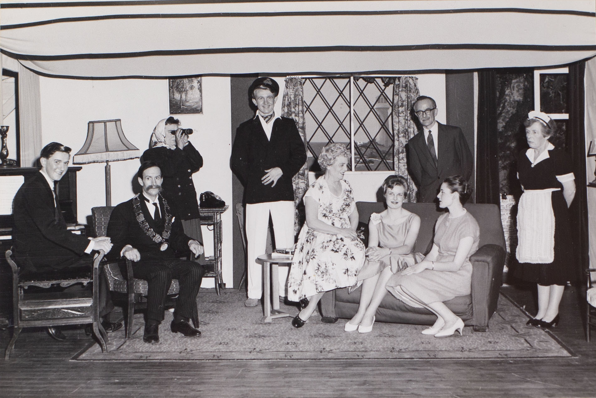 Photograph of actors in a scene from the 1960s play 'Blue Goose' performed by the Bishopsteignton Players