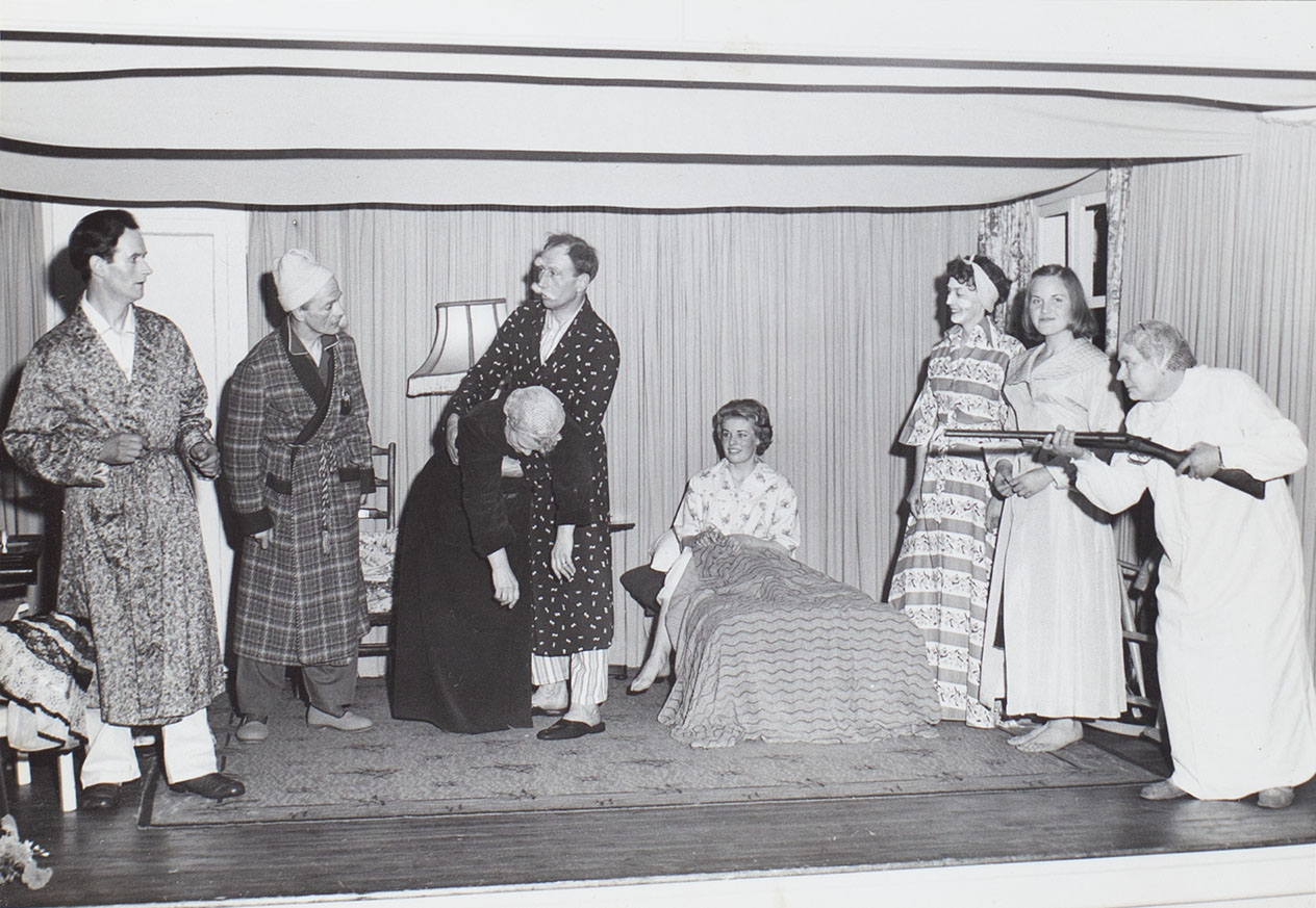 Photograph of actors in a scene from the 1960s play 'Jane Steps Out' performed by the Bishopsteignton Players