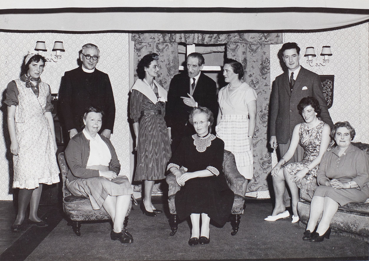 Photograph of actors in a scene from the 1960s play 'Akin to Love' performed by the Bishopsteignton Players