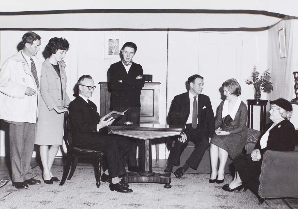 Photograph of actors in a scene from the play 'Love from a Stranger' performed by the Bishopsteignton Players in the 1960s