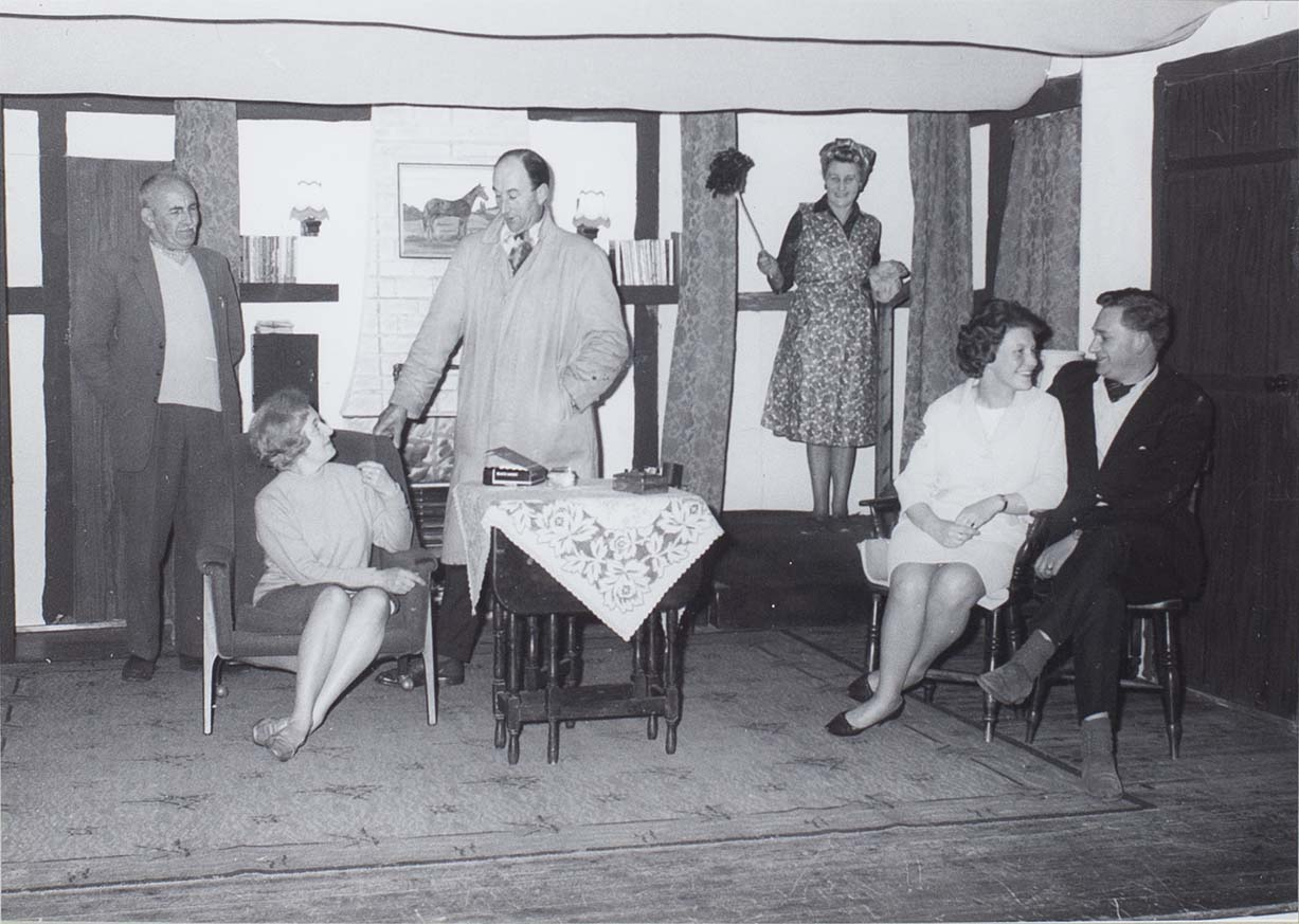 Photograph of actors in a scene from the play 'Intent to Murder' performed by the Bishopsteignton Players in the 1960s