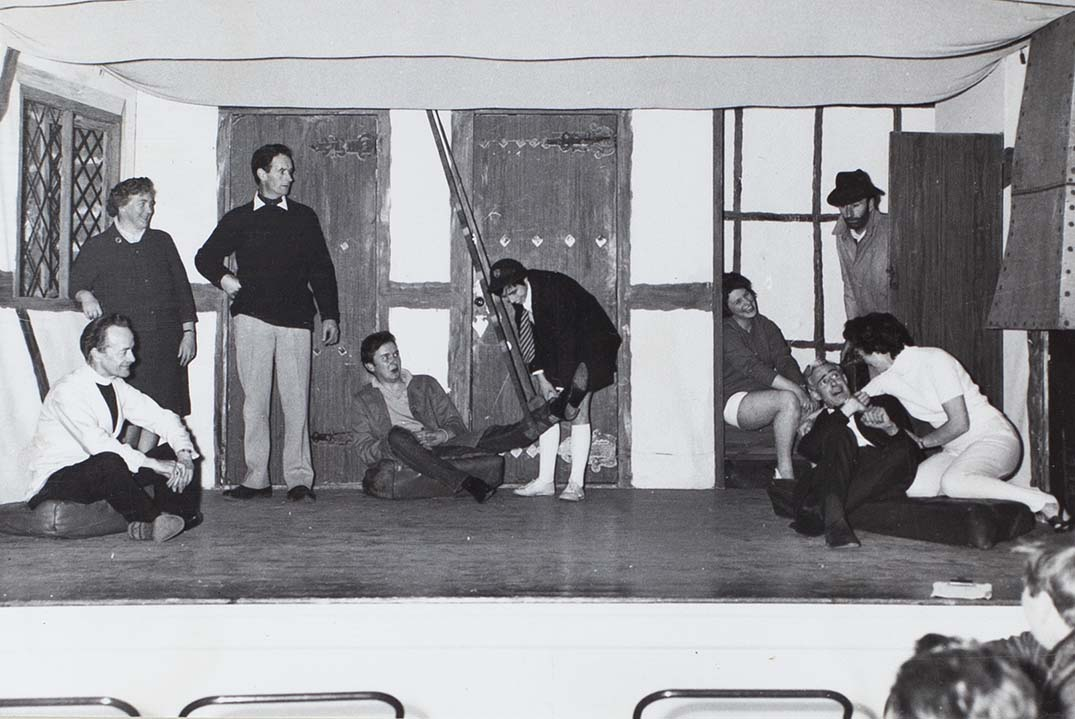 Photograph of actors in a scene from the play 'Here We Come Gathering' performed by the Bishopsteignton Players in the 1960s