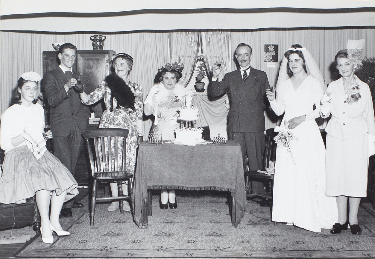 Photograph of actors in a scene from the play 'Orange Blossom' performed by the Bishopsteignton Players in the 1960s.