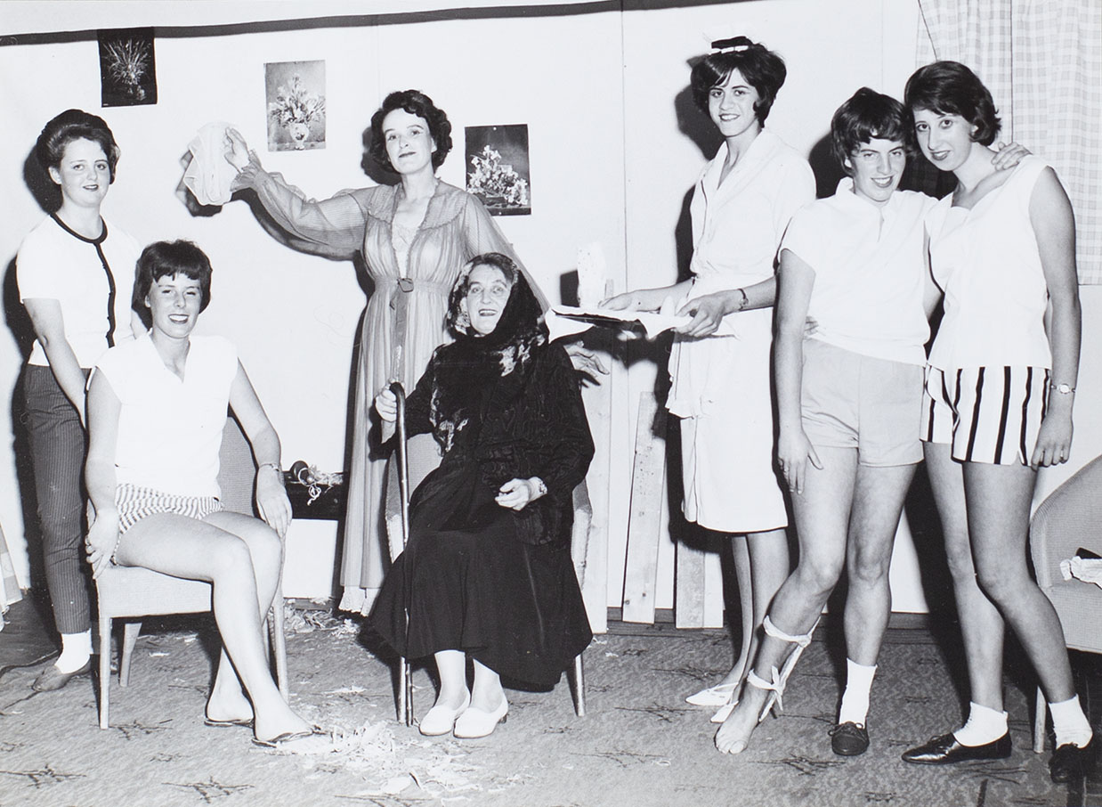 Photograph of actors in a scene from the play 'Mystery Cottage' performed by the Bishopsteignton Players in the 1960s