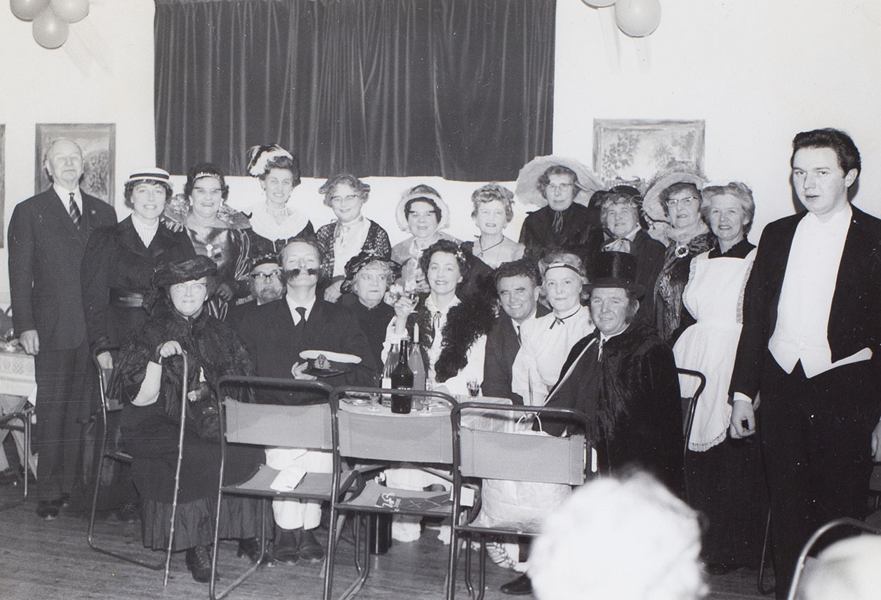 Photograph of actors and/or crew from the Bishopsteignton Players, at a social gathering in the 1960s